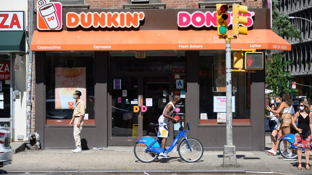America slowly walks by Dunkin', which, admittedly isn't as catchy or motivational a slogan.