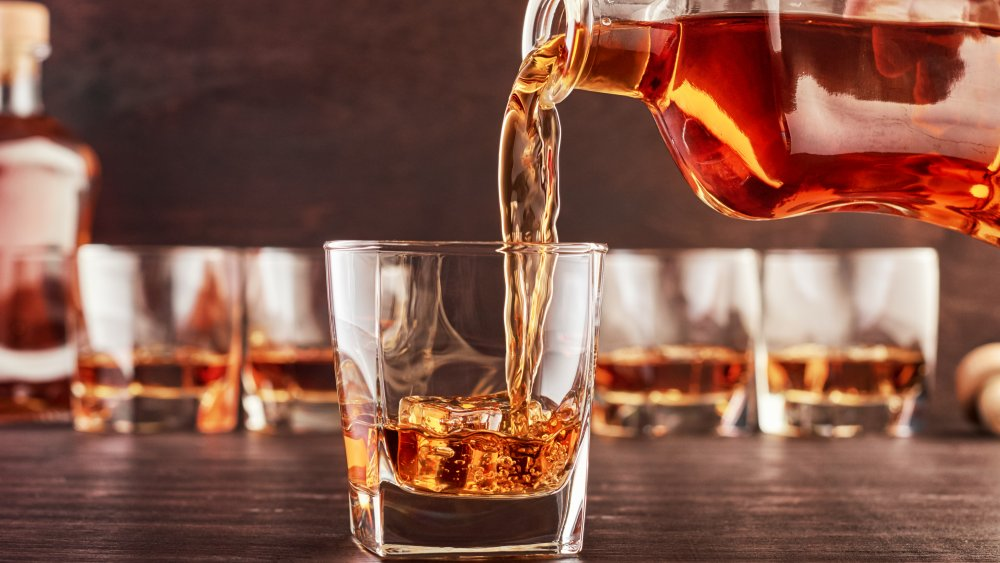 Pouring a glass of whiskey