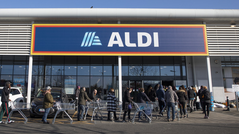 Customers line up in front of Aldi