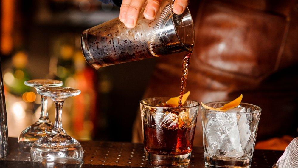 bartender serving liquor