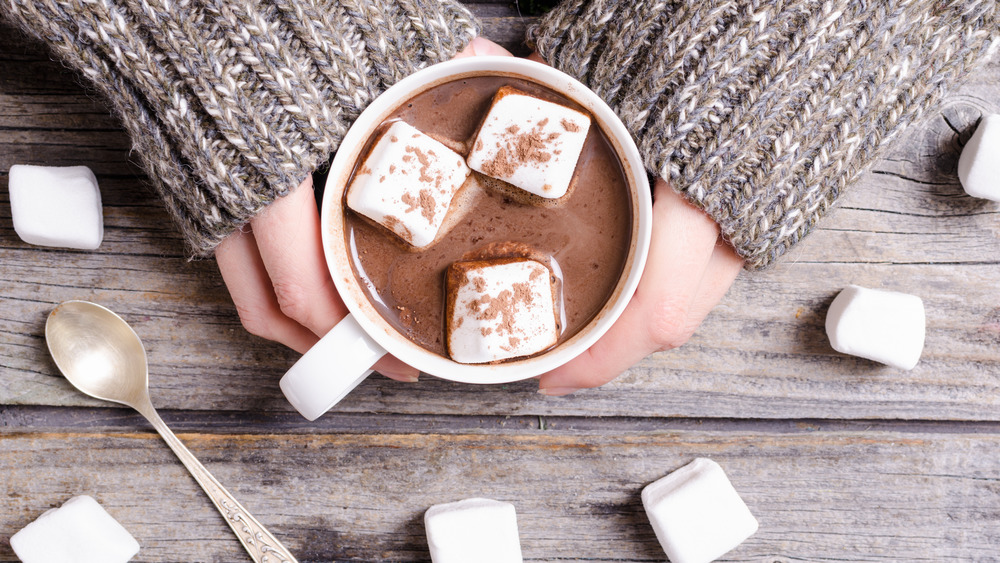 Woman holding hot chocolate