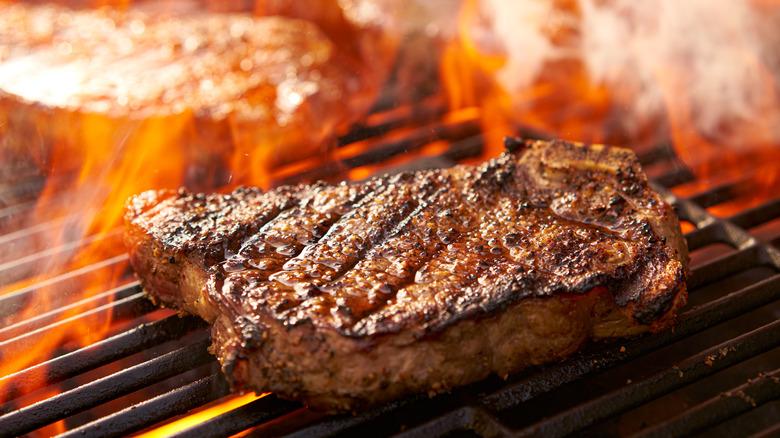 Ribeye steak on grill