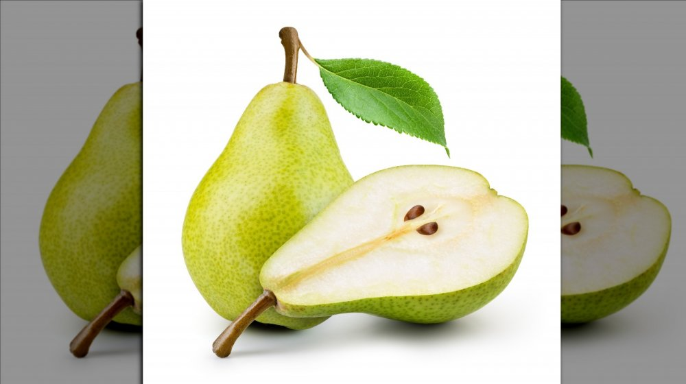 Whole and cut green pear