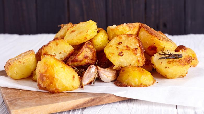 Board with roast potatoes