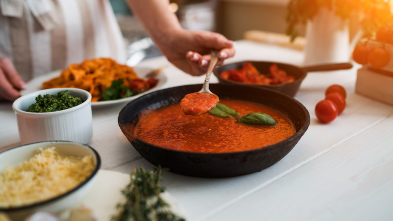 Red sauce in a black bowl
