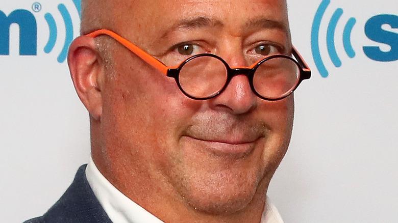 Andrew Zimmern wearing orange glasses