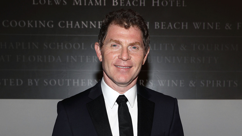 Bobby Flay dressed in a black suit