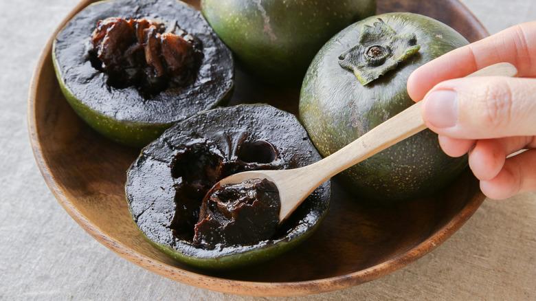 Black sapote in bowl