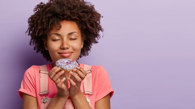 Girl holding a donut