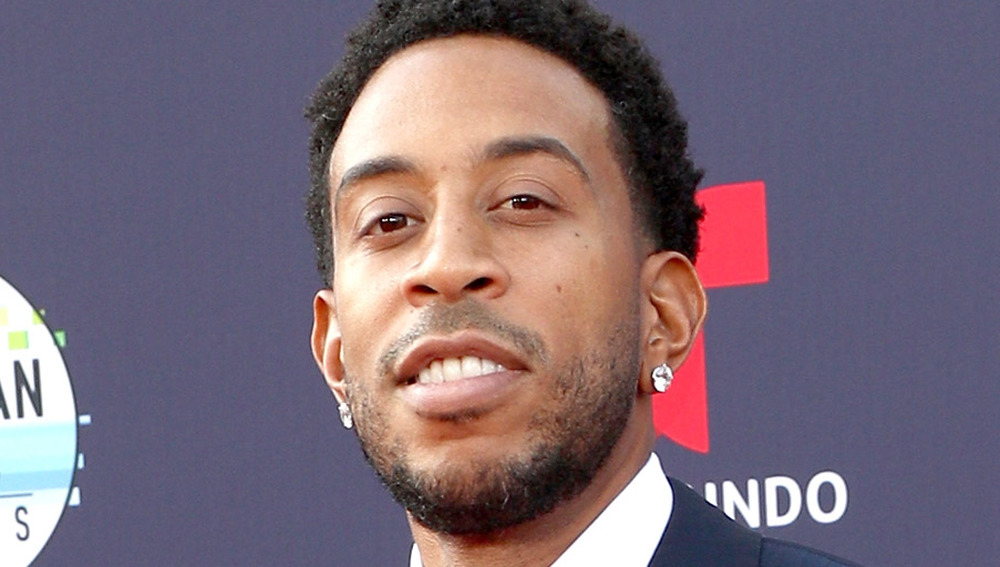 Ludacris smiling at an event