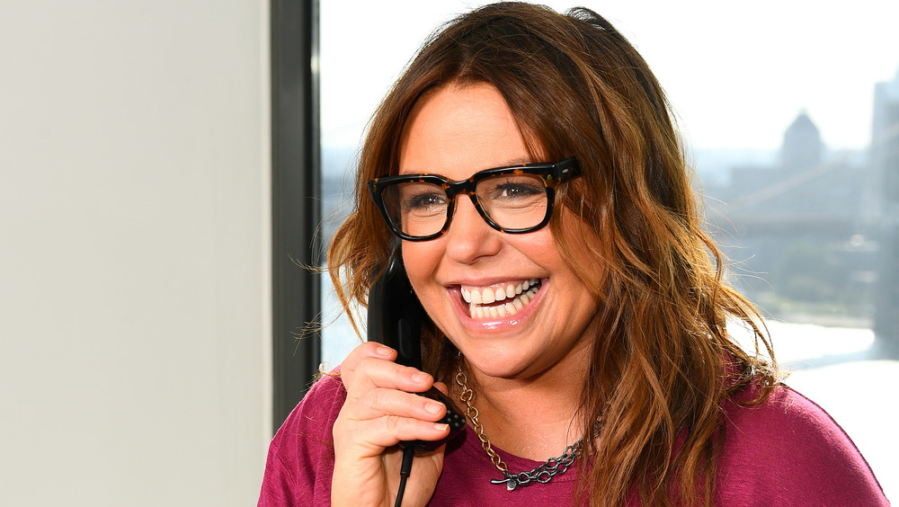 Rachael Ray smiling in glasses on the phone