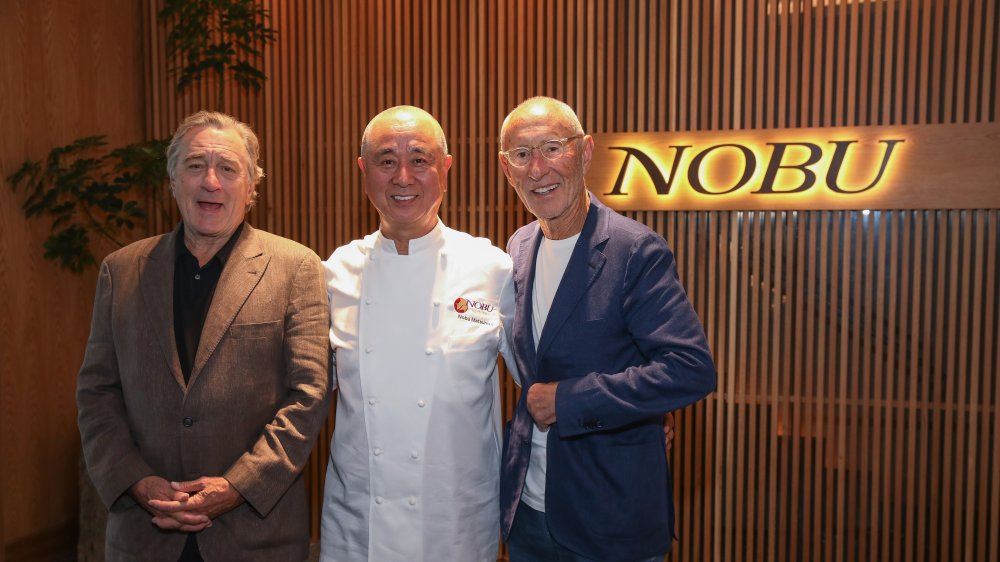 Nobu co-owners pose outside their restaurant