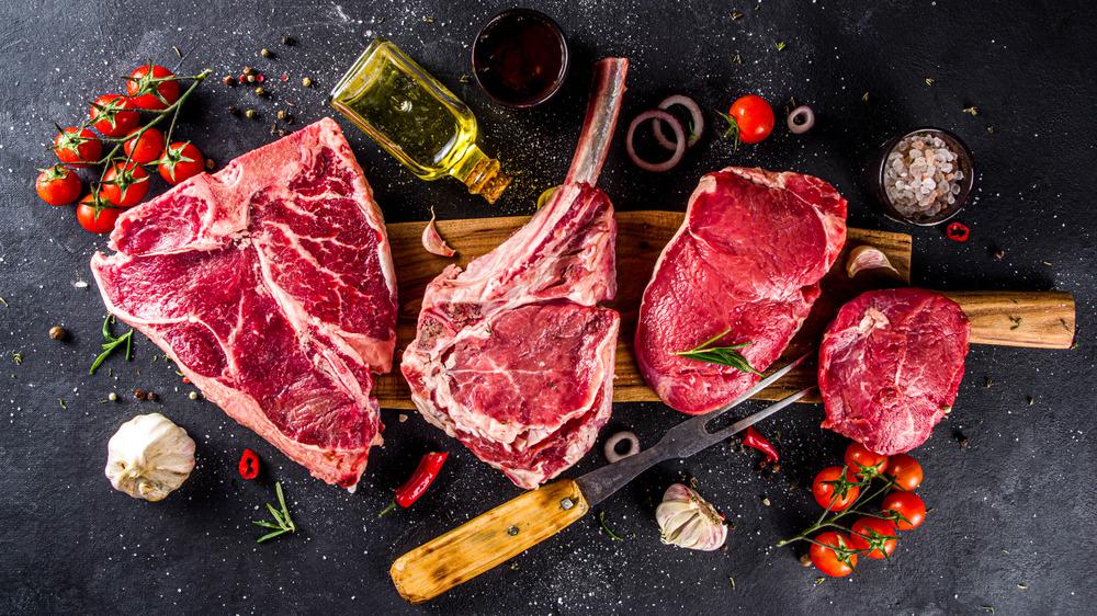raw steak on a black background