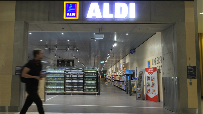 Person walking past Aldi entrance