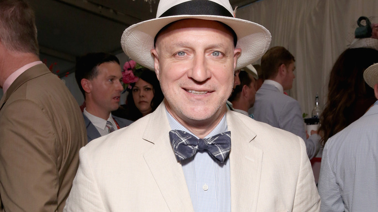 Chef Tom Colicchio in a white suit