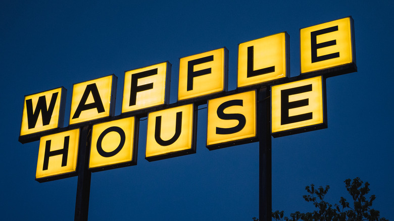 Waffle House sign and tree