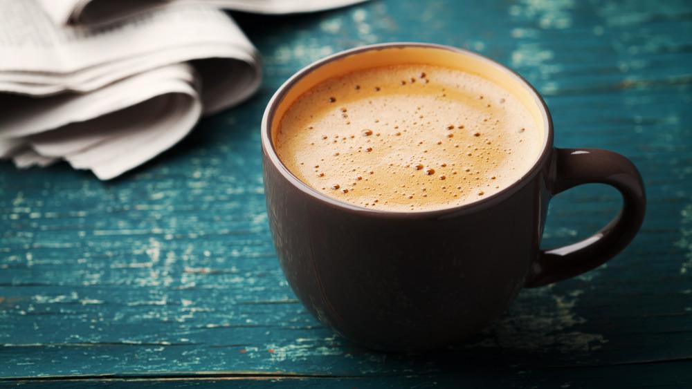 mug with creamy coffee