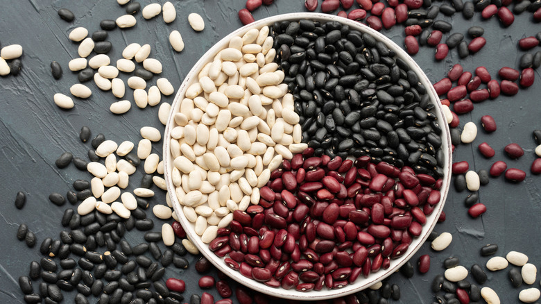 Colorful dried beans on plate