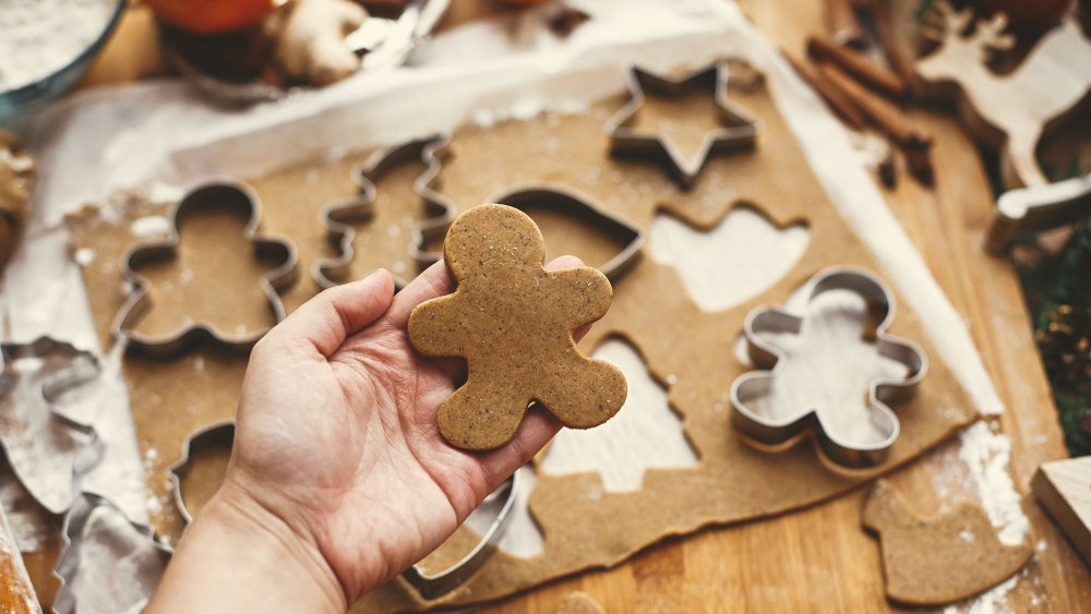 Gingerbread cookies rolled out for cookie cutters