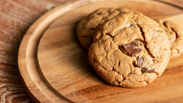 Chocolate chunk cookies on wooden tray