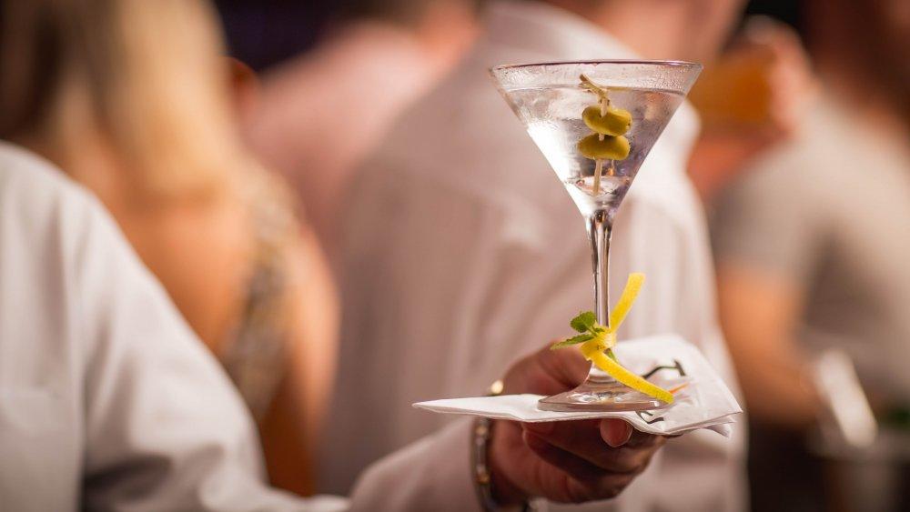 waiter holding a martini