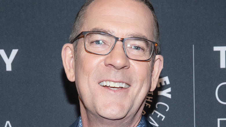Ted Allen in glasses and smiling