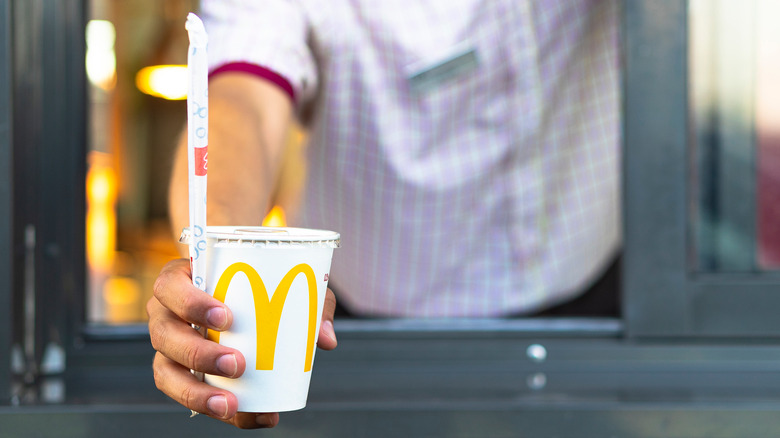 McDonald's employee hands out drink