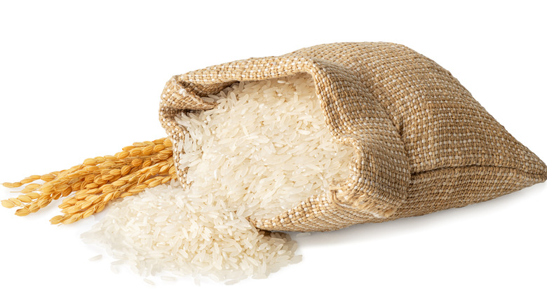 Rice spilling from burlap sack
