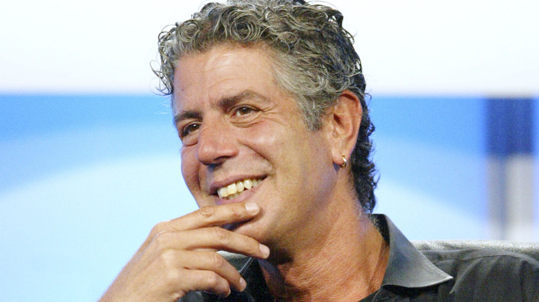 Anthony Bourdain with hand to his chin