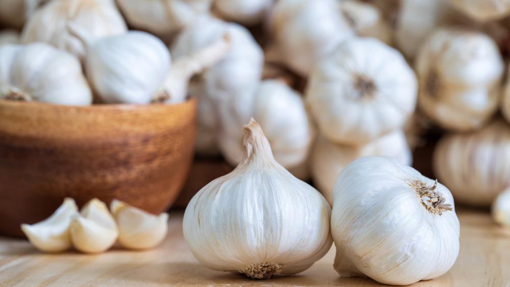 Garlic in a bowl on a cutting board