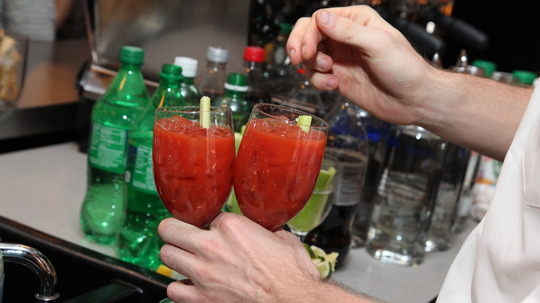 bartender making two bloody marys