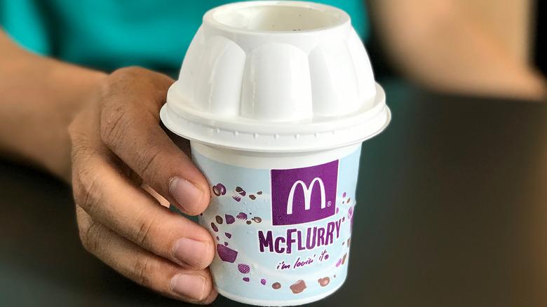 Hand holding McDonald's McFlurry ice cream