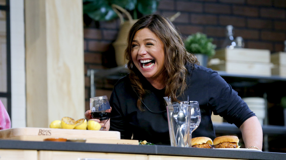 Rachael Ray on a set laughing