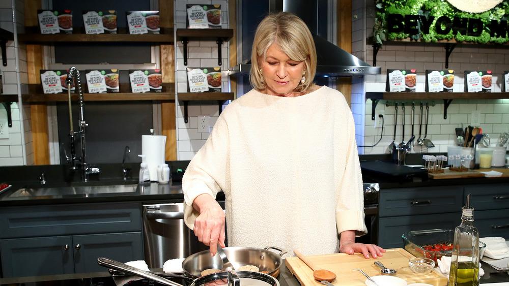 Martha Stewart cooking in her kitchen