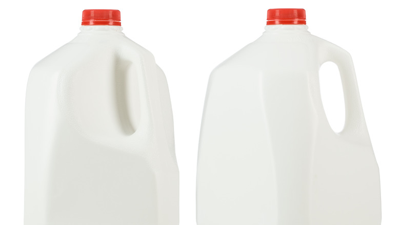 two plastic milk containers