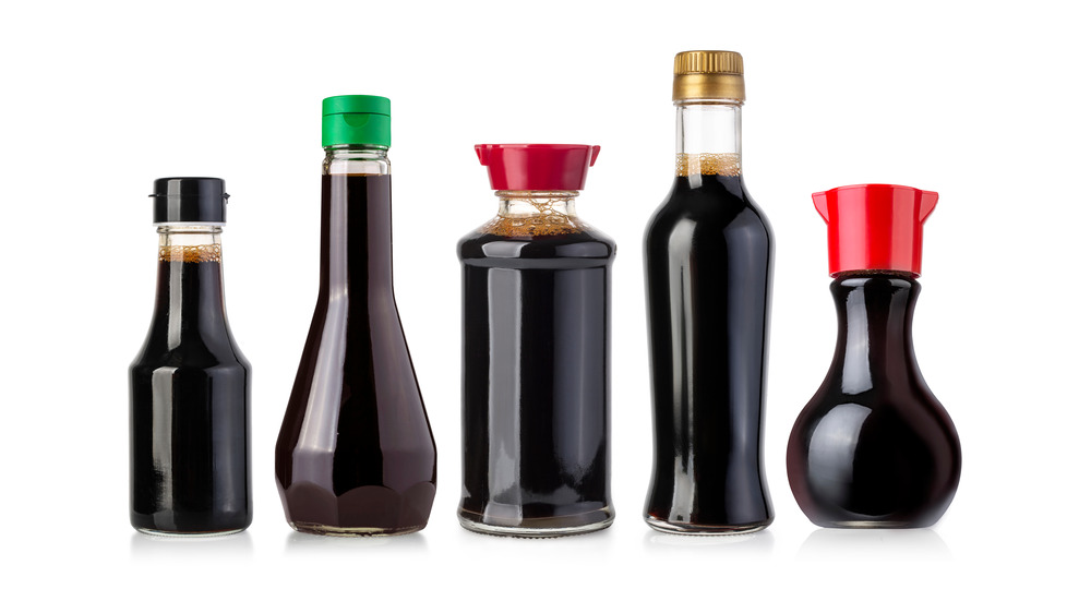 Five unlabeled bottles of soy sauce
