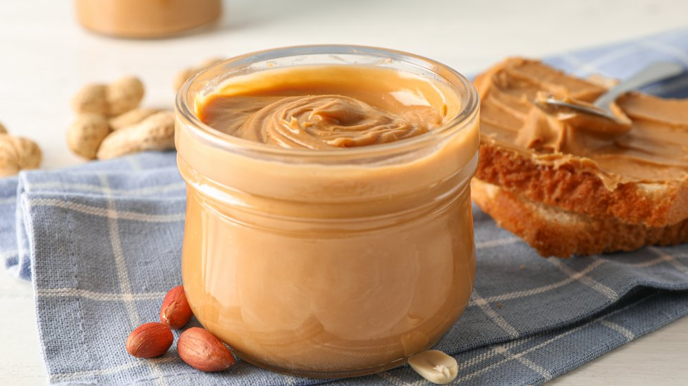 Peanut butter in a jar with toast