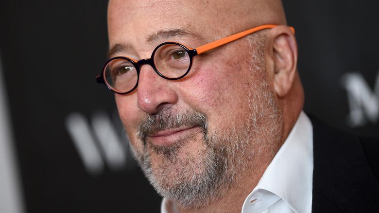 Andrew Zimmern close-up in orange glasses