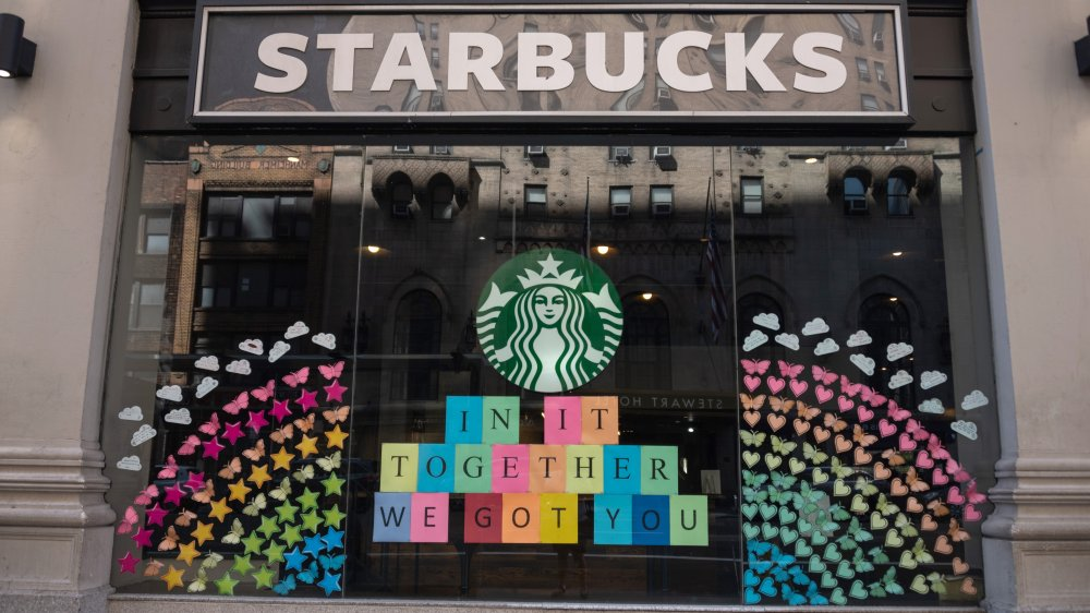 Starbucks store with a rainbow in the windows