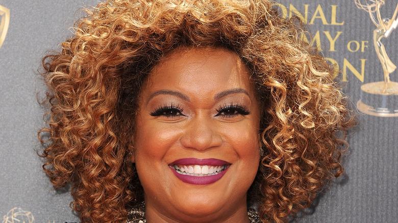 Sunny Anderson in plum-colored lipstick
