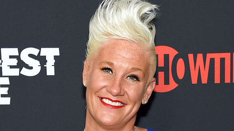 Anne Burrell smiling at an event