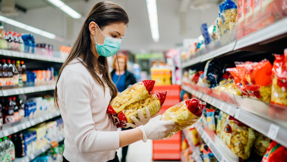 Person buying pasta mask gloves