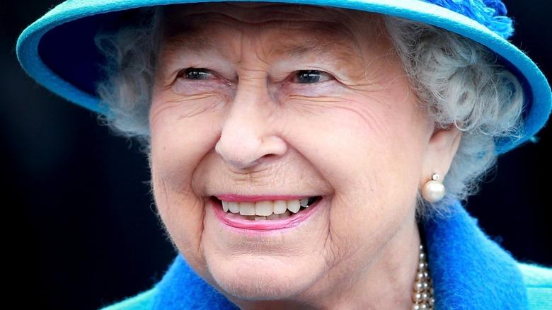Queen Elizabeth wearing a blue hat