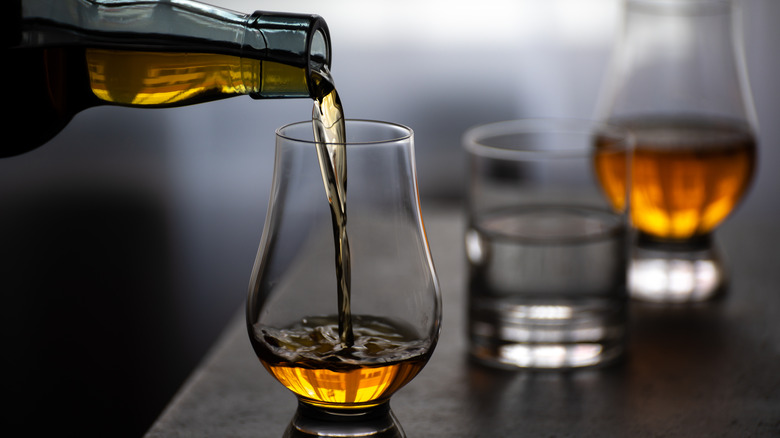 Whiskey being poured in a glass