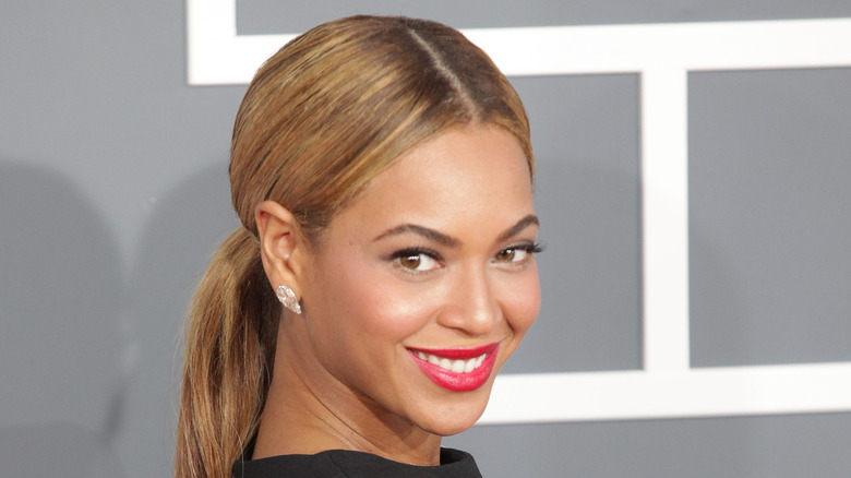 Beyoncé smiling and looking over her shoulder