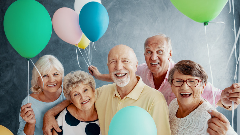 Elderly people with baloons