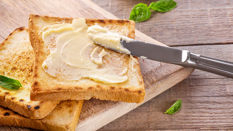 Butter with knife on toast