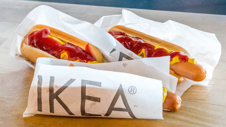 IKEA hot dogs in paper packaging with mustard and ketchup