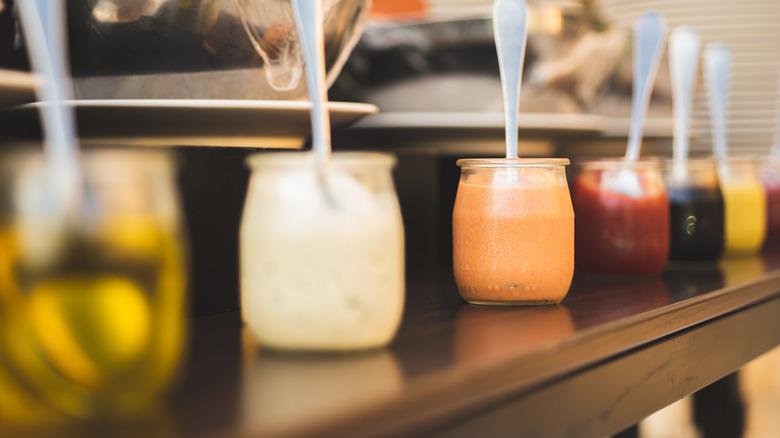 Assorted dressings in jars
