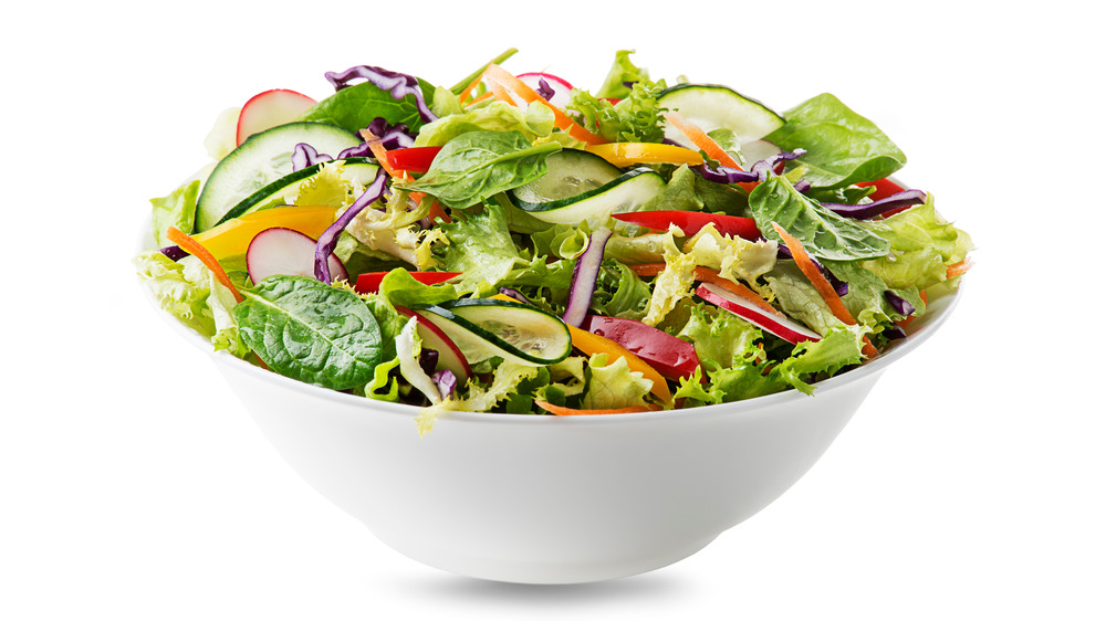 White bowl with green salad